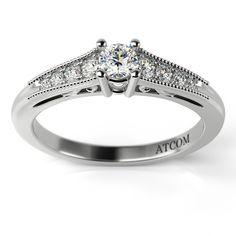 Inel de logodna cu finisaje deosebite, realizate pentru un efect general superb !