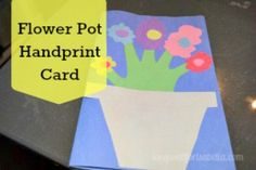 Create a hand print flower pot card. Perfect craft for the little ones.