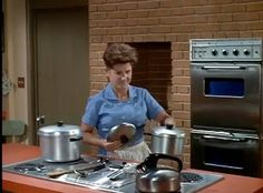 I'm still patiently waiting for ALICE from The Brady Bunch to come live at MY house!