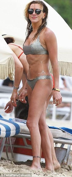 Ab-solutely ripped: The Arrow star flaunted her fantastic figure in a shimmering silver bi...
