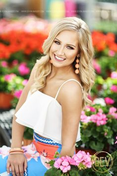 senior picture portrait idea with flowers at a nursery greenhouse