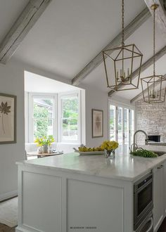 Gray Vaulted Kitchen Ceiling with Gray Wood Beams