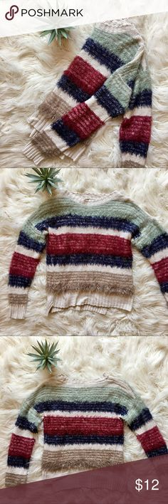 Soft & Cozy Striped Scoop Neck Sweater Soft & Cozy Striped Scoop Neck Sweater  - This fuzzy, warm and cozy sweater is adorable! Cream base with maroon/red, navy blue, dark tan, and light mint green stripes in a fuzzy material. It is slightly high-low, but with front hem a bit shorter than the back. It is not a crop top, but it sits right at the waistline of low rise jeans.  - PERFECT condition - no stains, tears, rips. Only been worn once! - Size small Blu Pepper Sweaters Crew & Scoop Necks