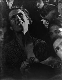 David Seymour - Spain, Extremadura, A peasant woman listens attentively to a political speech, 1936.
