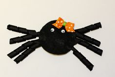 """Spooky Spider Felt Hair Clip: Materials:  8 - 2"""" korker ribbons (using 3/8"""" grosgrain ribbon)  1 - 4"""" (3/8"""") grosgrain ribbon  1 - 1/2"""" (1/4"""") grosgrain ribbon  1 piece of 3/4"""" x 4 1/2"""" black felt  2"""" snap clip  2 5mm wiggly eyes  circle template (download here)  toothpick (I have no idea why I got two pictured!)  mini bow making kit (learn how to make it here)  scissors  hot glue gun"""