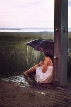 Even when its man made rain from an outdoor shower, that sound on the umbrella and the water coming down around you.....heavenly!