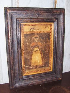"""Watercolor by Steve Shelton of a primitive Lady in a painted and distressed frame. """"Maria""""  Whitehorse Antiques, Rocheport, Mo."""