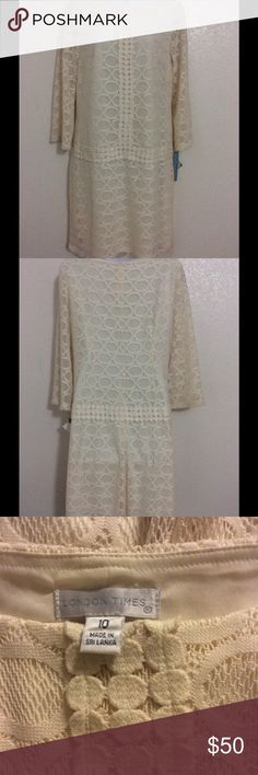 London Times Lace Dress Absolutely gorgeous Ivory color dress from London Times.  Fully Lined.  100% polyester.  Machine washable.  Measures 18 inches armpit to armpit, flat.  Measures 32 inches shoulder to hem. New with tags attached. London Times Dresses