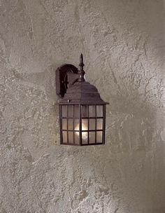 """The Great Outdoors 8717-91 1 Light Wall Mount 1-100W Antique Bronze Bridgeport by Minka. $38.00. The Great Outdoors 8717-91 1 Light Wall Mount in Antiques Bronze Finish w/Textured Glass 1-100W 6""""W x 14 1/2""""H x 6 3/4""""Ext. Textured Glass Medium Base"""