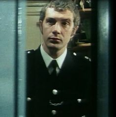 Lewis Collins as a copper.