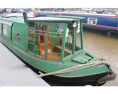 Glass cratch cover on a narrowboat - much prettier than a canvas one and makes a lovely conservatory - but in danger of getting broken in tight spaces!