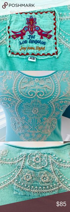 """JOHNNY WAS  Embroidered Tee Aqua Turquoise Adorable short-sleeve tee by designer JOHNNY WAS / JW Los Angeles! Aqua with cream embroidery across the bodice, neck back, and fully around the bottom hem. Super soft luxurious 100% cotton. No flaws observed. Excellent condition. Approximate FLAT measure is 16"""" bust, 26"""" length, 18"""" hem. Johnny Was Tops Tees - Short Sleeve"""