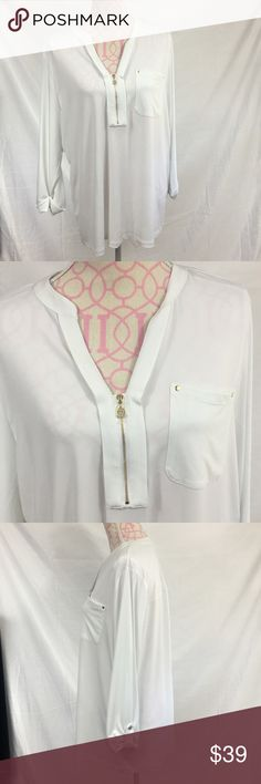 NWT ANNE KLEIN PLUS SIZE TOP New Anne Klein white top. Gold button detailing. V neck.  Size 1X Bust approximately 42 inches  Length approximately 27 inches 96% polyester/ 4% elastane Anne Klein Tops Blouses
