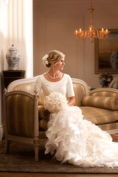 an elbow sleeve modest wedding dress. The top of this dress would look good on mom. But I don't really like the bottom..