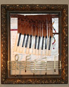 Reuse of old piano keys,sheet music brass, old frame