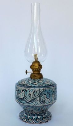 """Oil Lamp """"Azul Line"""". Oil Lamp in majolica hand-painted. The Decoration is in floral Style, light Blue and Blue on 'craquelè' Varnish."""