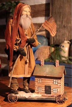 Primitive Santa with Log Cabin - Arnett's Country Store