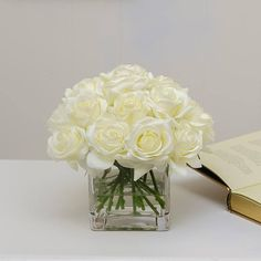 This cute design has about 2 dozens real touch white roses in a square glass vase filled with faux water. The artificial roses can bring nature inside and brighten your space, especially for small tables at home or desk in the office. White Rose Centerpieces, White Flower Arrangements, Artificial Flower Arrangements, Wedding Arrangements, Wedding Centerpieces, Silk Arrangements, Artificial Flowers, Faux Flowers, Silk Flowers
