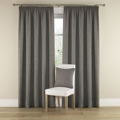Pair of fully lined curtains with eyelet heading in a plain natural looking hessian fabric with a fluid drape.