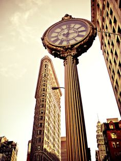 The Flatiron Building and Fifth Avenue Building Clock. Midtown.