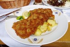 """Austrian Fried Chicken!"" ... Actually, it's Weiner Schnitzel -- pounded, breaded and fried cutlets served over amazingly good potatoes."