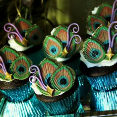 """Peacock cupcakes @Erin Quinn If you don't like the peacock idea --- just lemme know!!! I'm just browsing!!! I'll make some """"rough drafts"""" and put them online and we can work from there.."""