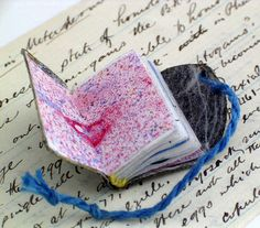 Handmade miniature book with marbled endpaper by Ruth Bleakley