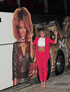 Going strong: Fleur East celebrates sailing through to the X Factor finals and landing her own branded tour bus