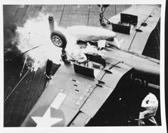 """USS Essex (CV-9) - Fire erupts from an F4U Corsair fighter after it crashed into the barrier, 8 April 1945. Gasoline from the damaged belly tank ignited when it hit the plane's hot engine. The fire was quickly extinguished by the flight deck fire..."