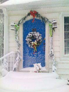 blue door in snow