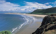 Rhossili Bay on the Gower Peninsula, West Glamorgan, UK Named Britain's best picnic spot by travel writers.