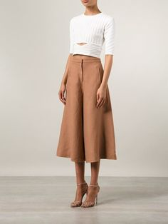 I like that the culottes almost look like a skirt. Love the top.