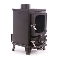 The Hobbit Stove is a small cast iron multi fuel stove from Salamander Stoves using the Turboblaze technology, the glass stays clean, is efficient and comes with 5 year guarantee. Small Wood Burning Stove, Tiny Wood Stove, Small Stove, Small Fireplace, Stove Fireplace, Multi Fuel Stove, Cast Iron Stove, Cooking Stove, Cozy Cabin