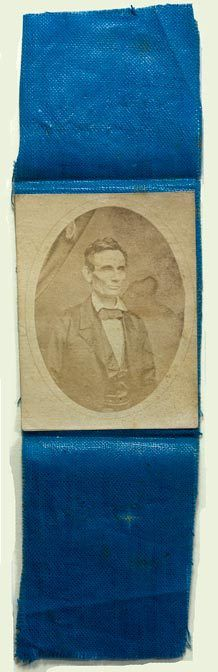 Silk political ribbon for Lincoln's Presidential Campaign of 1860, with an 1858 photo of Lincoln by Roderick Cole  - would have been pinned to a jacket.