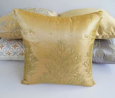 A elegant range of festive pillows in gold , silver, red and green. pillows, decorative pillows, throw pillows