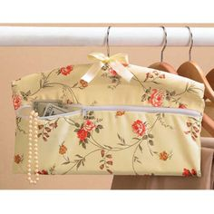 "Closet Hanger Safe Hide your valuables where no one would think to look. Our pretty, floral print hanger has a secret pocket. Place jewelry, cash or treasures inside, zip it up, slip a blouse or jacket overtop and hang on your closet rod. Polyester/cotton. Imported. 16""w, 8""h."