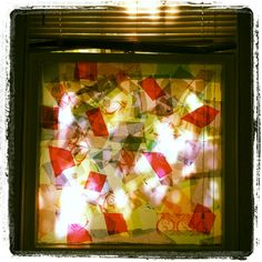DIY stained glass = tissue paper + spray starch