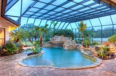 Tropical Swimming Pool with exterior tile floors, Skylight, Indoor pool, Pool with hot tub, exterior stone floors Pool Indoor, Swimming Pools Backyard, Swimming Pool Designs, Lap Pools, Pool Decks, Landscaping Around Pool, Landscaping Design, Tropical Landscaping, Garden Landscaping