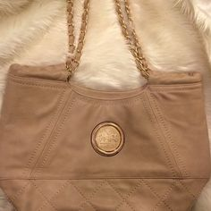 SALE Gorgeous Tan Coach Purse Beautiful heavy duty bag! Features criss cross stitching and beautiful chain handles! Only sign of wear are the light gray streaks show  above. Inside features many leather pockets. Real leather and gold plated. This was given as a gift so I'm not 100% on the authenticity. Therefor the price is very negotiable! Coach Bags Shoulder Bags