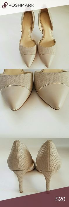 Calvin Klein taupe snakeskin shoes Like new Calvin Klein snakeskin and gold trim shoes size 7.  In second picture is the only flaw. Not noticeable while wearing. I got lots of compliments the 2 hours I wore them to a wedding. Just too tight for my feet! From smoke free clean home, no paypal, no merc, bundle and make a deal! Calvin Klein Shoes Heels