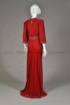 """Red velvet dress with gold braid   Label: """"Bergdorf Goodman""""  American, circa 1936.  Velvet, gold braid, via Collection of the Kent State University Museum."""