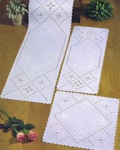 Crisp white mats with openwork and satin stitch roses.