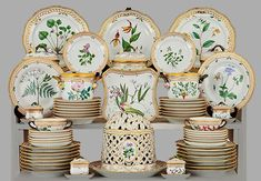 """A complete set for 24, """"Flora Danica"""" dinner service, Denmark; each piece is exquisitely hand-painted with a botanical design in the Royal Copenhagen factory."""