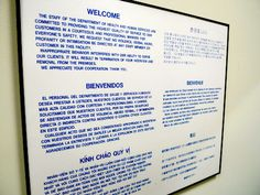 A Sign Displayed in Department of Health and Human Services: The welcome message is available in six different languages