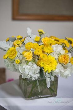 yellow and gray wedding flowers centerpiece  http://www.sophisticatedfloral.com/