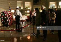 Visitors walk by the casket of Rosa Parks during visitation at the Charles H. Wright Museum of African American History on October 31, 2005 in Detroit, Michigan. Parks, the woman who refused to give up her seat to a white man on a Montgomery, Alabama city bus in 1955, is credited for sparking the American civil rights movement. Parks will lie in honor at the museum until 5am November 2, and her funeral will take place at 11am at Greater Grace Temple in Detroit.