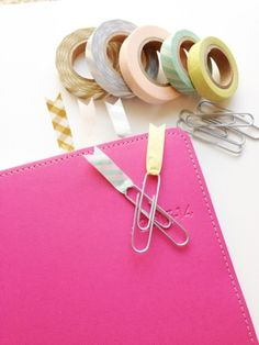 Adding a touch of color to your paperclips makes them double as easily visible bookmarks
