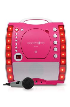Free shipping and returns on Singing Machine Classic 'SML343P' Portable Karaoke Machine at Nordstrom.com. A front-loading CD player makes it easy to cue up your next song in a party-ready karaoke machine that features fun, disco-inspired lights and RCA output jacks to scroll the lyrics on your TV. Perfect for sleepovers!