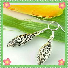 Silver plated filigree earrings. Pretty and delicate. New with tag.  Approximately 1 inch long. The hooks are sterling silver (stamped 925 ). Jewelry Earrings