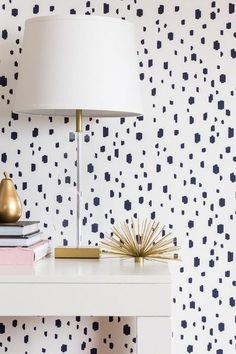 This abstract dalmatian print in deep navy is an absolute stunner. It will give your room a unique, hand-painted feel while creating a neutral backdrop to pair with endless color schemes. Navy, blush,